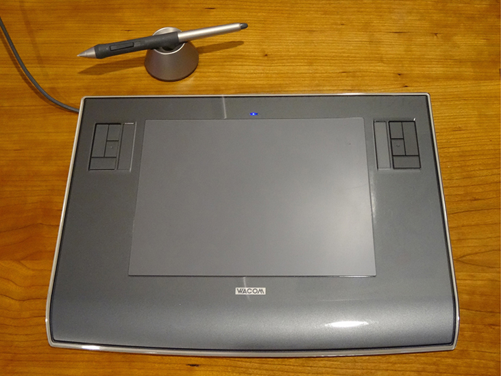 Photograph shows a digital tablet with a stylus.