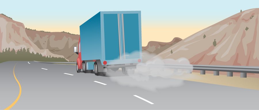 Figure shows a truck on a road. There is smoke near its tires.