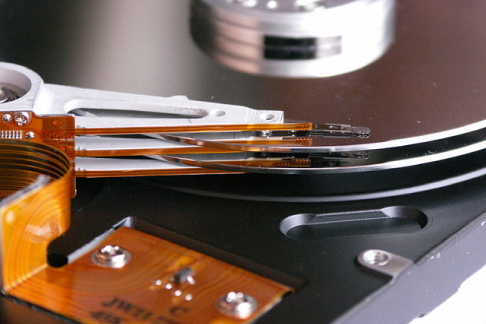 A photo of the read mechanism of a hard drive.