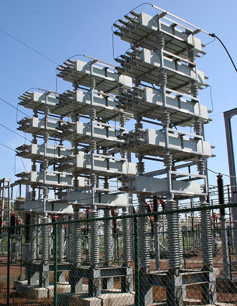 Photograph of power capacitors at a power station.