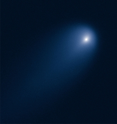 A Hubble Telescope photo of a comet. It appears as a bright dot with fuzzy light around it.