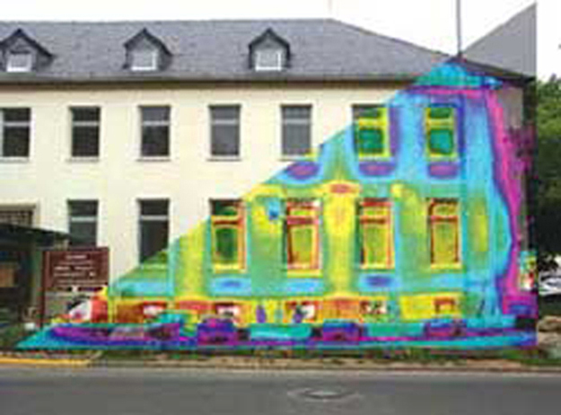 Figure shows a photograph of a building overlaid by its thermograph. The thermograph shows different areas of the building in different colours. The windows are yellow with red frames.
