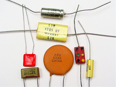 A photograph of different types of capacitors.