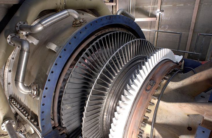 Photograph shows a steam turbine generator.