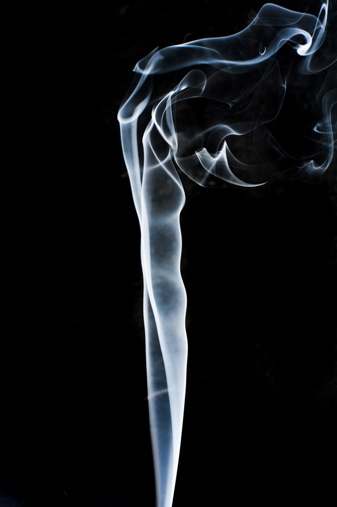 Photograph of smoke rising smoothly for a while and then beginning to form swirls and eddies.