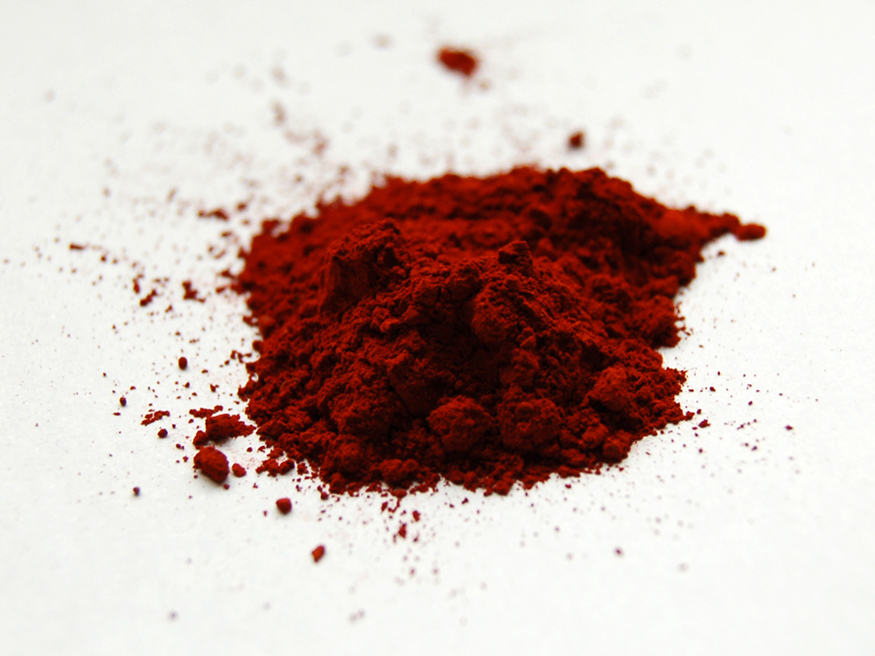 The image shows fluorescent dye sample in red powder form.