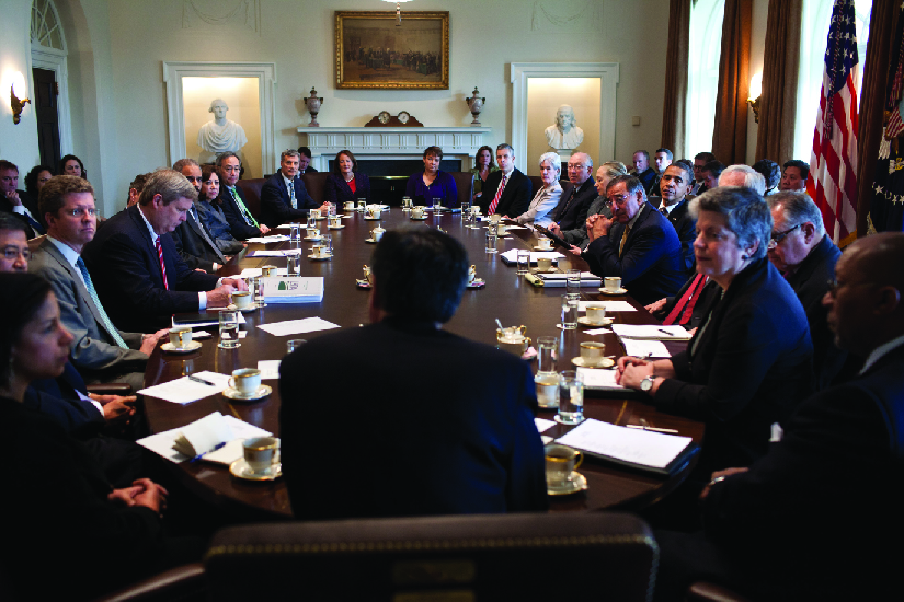 A photo of cabinet members holding a meeting in the Cabinet Room.