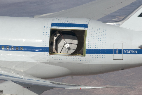 Image of the interior of the SOFIA aircraft, showing the massive telescope and supporting instruments that fill a substantial portion of the cabin.