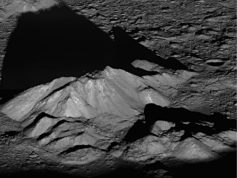 Sunrise on the Central Mountain Peaks of Tycho Crater. This compact mountain range casts a long shadow on the flat floor of Tycho in this image from the Lunar Reconnaissance Orbiter.
