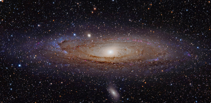 The Andromeda Galaxy. The compact nucleus of our nearest large galactic neighbor is seen at the center of this visible light image, with the blue spiral arms and thick dust lanes circling around the outer parts of the galaxy.