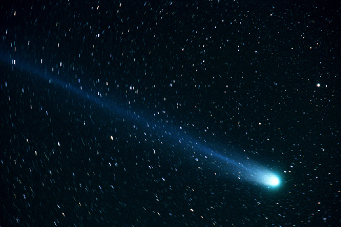 Comet Hyakutake. The nucleus is seen at lower right, and the tail stretched from the nucleus to upper left in this photograph from 1996.