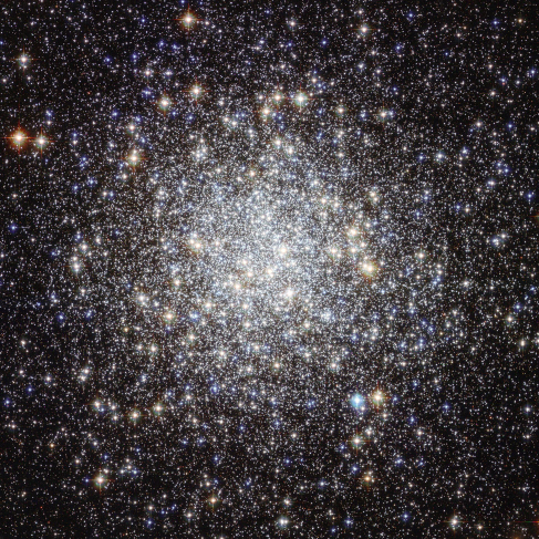 Image of a Star Cluster. This Hubble Space Telescope image of M9 shows a dense circular-shaped grouping of stars. The number of stars drops off dramatically toward the edges of the image, away from the center of the cluster.