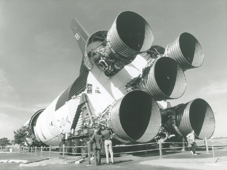 Moon Rocket on Display. Visitors stand in front of the five thrust nozzles of a massive Saturn 5 rocket outside NASA's Johnson Space Center in Houston.