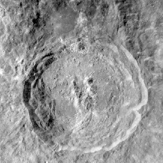 Photograph of King Crater on the Moon. This crater has the main features of a large impact: circular in shape, terraced walls, flat floor and central peaks.