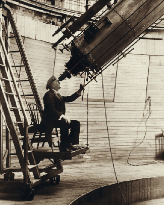 This is a photograph of Percival Lowell seated at the eyepiece of the 24-inch refractor near Flagstaff, Arizona.
