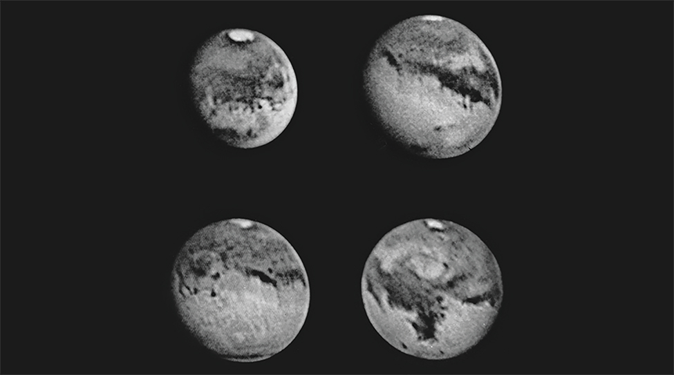 The entire surface of Mars in four photographs. The white polar ice cap is visible at the top of each image along with several cloud formations and dark surface markings.