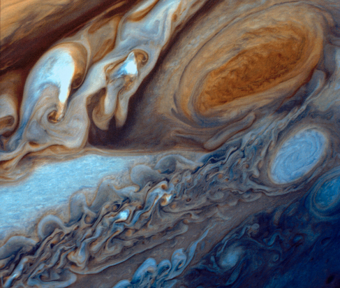 Jupiter's Great Red Spot. A highly enhanced image from the Voyager probe showing the same region seen in Figure 11_01_Jupiter, but with much greater color contrast allowing much finer features and details to be discerned.