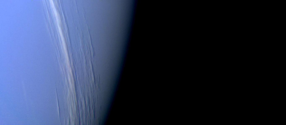 The White Clouds of Neptune. Thin clouds of methane ice crystals run nearly vertically from top to bottom center in this Voyager image of Neptune. These clouds have the appearance of cirrus clouds frequently seen on Earth.