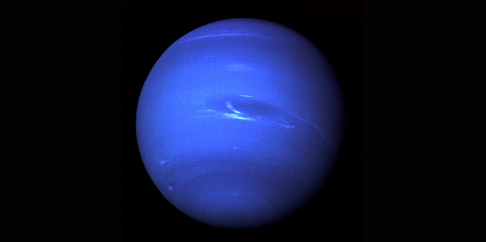 Blue Neptune. The blue sphere of Uranus is nearly featureless, save for dark bands near the poles, a few scattered white clouds, and a dark spot (near the center in this image) similar to the Great Red Spot on Jupiter.