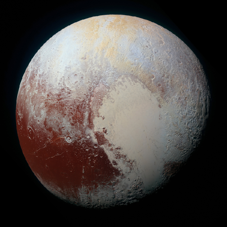 A global color image of Pluto, showing a dark area in the lower left covered with impact craters, and a larger light area in the center and lower right that is flat.