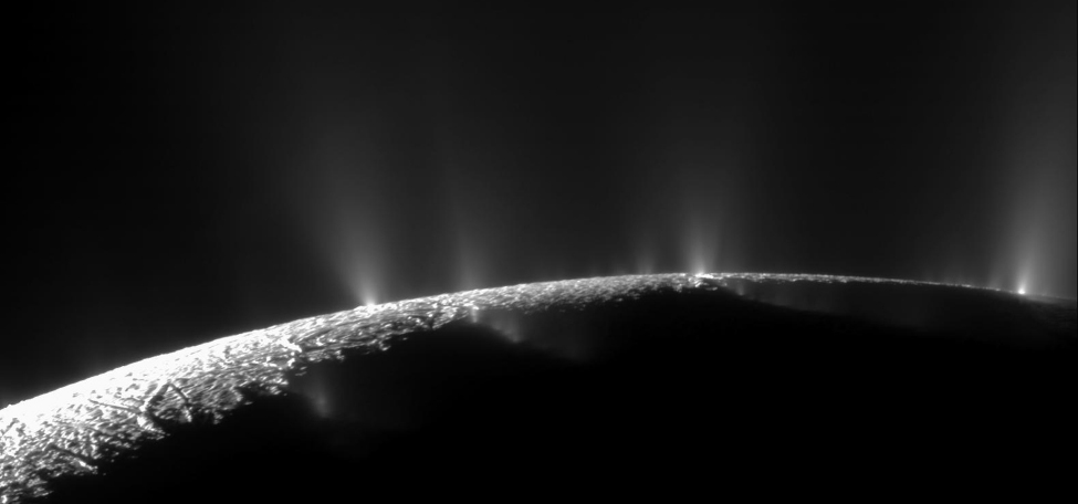 An image of the surface of Enceladus, from which a number of water geysers stream.
