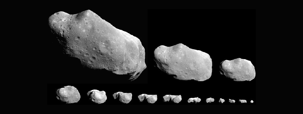 An image of several irregular shaped asteroids.