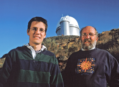 Planet Discoverers. An image of Didier Queloz and Michel Mayor, with an observatory in the background.