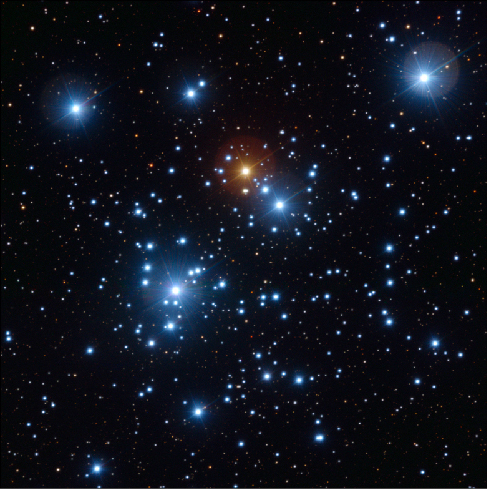 "The Open Cluster N G C 4755. This open cluster, known as the ""Jewel Box,"" contains many bright white and blue stars as well as a bright yellow supergiant near the center."