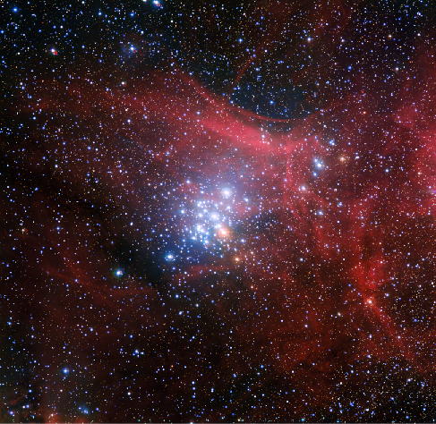 Image of N G C 3293. This compact cluster of bright, blue stars is located near the center of this image surrounded by the red wisps of ionized hydrogen left over after the cluster's formation.
