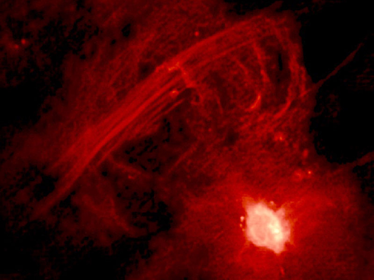 "Central 10 Light-Years of the Galaxy. The bright region at lower right is Sagittarius A* and the straight filaments running from lower left to upper right are collectively known as ""The Arc"". See [Figure 25_04_RImage] to see these features in context with other objects near the galactic center."