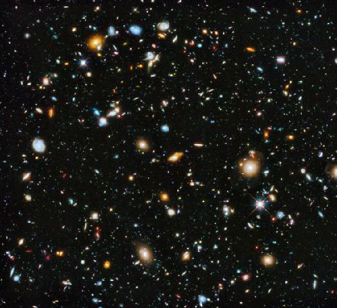 Hubble Ultra Deep Field. This remarkable HST image contains many thousands of galaxies of all morphological types uniformly spread over the entire frame.
