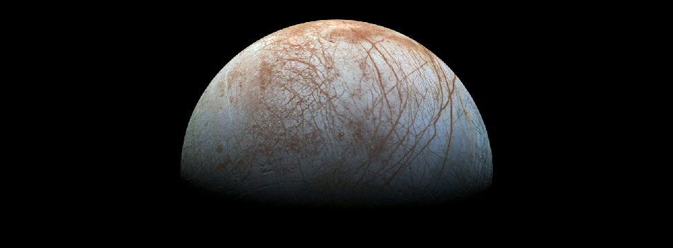 Europa. The surface of Europa is covered with networks of long cracks and large areas of jumbled terrain suggestive of geologic activity.